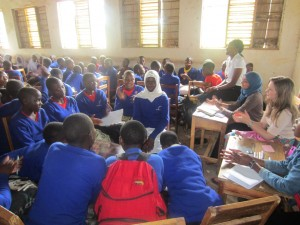 Samia (second from right wearing headscarf) with fellow VSO ICS volunteers Flora John Moshi and Catriona Mckayand at a sexual and reproductive health session at Rutabo Secondary School