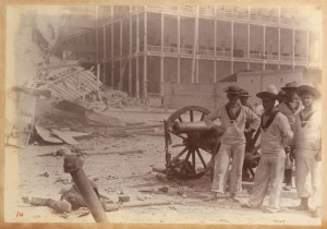 Group of British sailors posing in front of the Beit al-Ajaib - Bombardment of Zanzibar 1896 - Winterton Collection of East African Photographs: 58-5-2