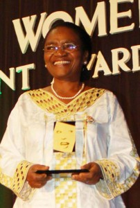 Prof. Mwaikambo receiving a Tanzanian Woman of Achievement Award in 2009