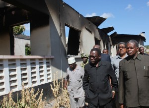 Prime Minister Mizengo Pinda visits the fire damaged courts in Mtwara following the rioting - photo State House
